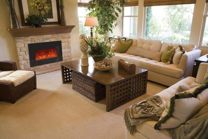 Medium Insert Electric Fireplace with Black Glass Surround and Fire Glass in Living Room